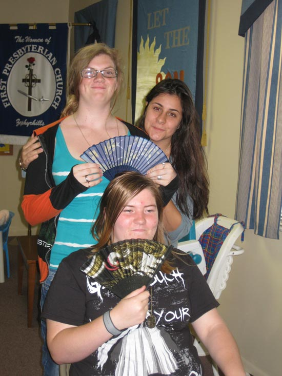 Youth Group girls with fans.  It must be hot!